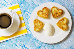 Cottage cheese pancakes with heart shaped Stock Photos