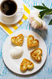 Cottage cheese pancakes with heart shaped Royalty Free Stock Image