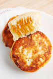 Cottage cheese pancakes and honey Royalty Free Stock Photos