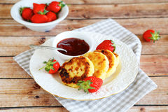 Cottage cheese pancakes with jam and berries Stock Image