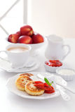Cottage cheese pancakes with jam and sour cream for breakfast Stock Images