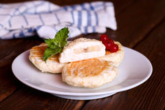Cottage cheese pancakes with mint and banana Royalty Free Stock Photos