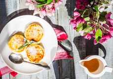 Cottage cheese pancakes with mint and powdered sugar, flowers,ch Royalty Free Stock Photos
