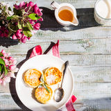 Cottage cheese pancakes with mint and powdered sugar, flowers,to Royalty Free Stock Photo