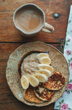 Cottage cheese pancakes and porridge. Cottage cheese pancakes with banana and wheat porridge Royalty Free Stock Images