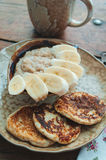 Cottage cheese pancakes and porridge. Cottage cheese pancakes with banana and wheat porridge Stock Photography