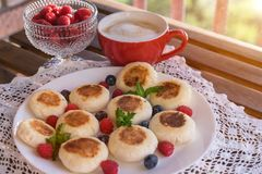 Cottage cheese pancakes with raspberries. Breakfast set Royalty Free Stock Images