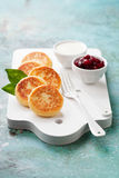 Cottage Cheese Pancakes Russian Syrniki With Cranberry Jam And Yogurt Stock Photography
