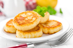 Cottage cheese pancakes, syrniki Stock Photos