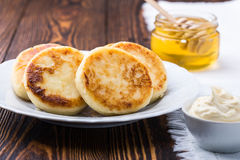 Cottage cheese pancakes, syrniki Stock Image