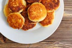 Cottage cheese pancakes on white dish Royalty Free Stock Photos