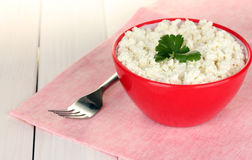 Cottage cheese with parsley in red bowl Stock Photography