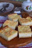 Cottage cheese pie. Homemade baking. Rustic grated cake bars on a wooden board.  royalty free stock images