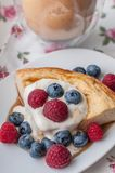 Cottage cheese pie with honey yogurt and berries. Cottage cheese casserole with honey yogurt and berries Stock Image