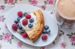 Cottage cheese pie with honey yogurt and berries. Cottage cheese casserole with honey yogurt and berries Stock Photo
