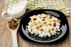 Cottage cheese with pieces of apples, raisins, sour cream Royalty Free Stock Images