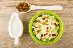Cottage cheese with pieces of apples and raisins, sour cream Stock Photo