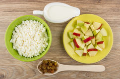 Cottage cheese, pieces of apples, sour cream and raisins Royalty Free Stock Photo