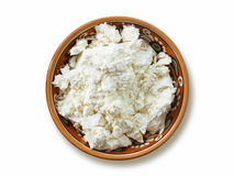 Cottage cheese in plate isolated on white background Stock Images