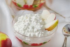 Cottage cheese plate with slices of Apple stock photo