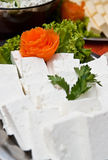 Cottage cheese platter. Blocks of white cottage cheese on a buffet platter Stock Photo
