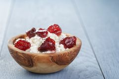 Cottage cheese with preserved strawberry on blue Stock Photography