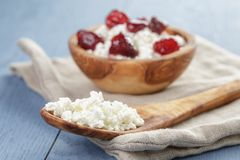 Cottage cheese with preserved strawberry on blue Stock Images
