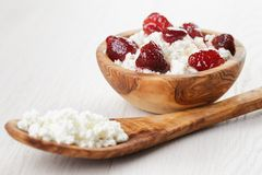 Cottage cheese with preserved strawberry in wood Royalty Free Stock Photo