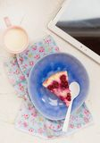 Cottage cheese pudding with cherry, a milk cup for a breakfast on . Stock Photography