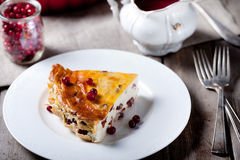 Cottage cheese pudding with  cranberry sauce Royalty Free Stock Image