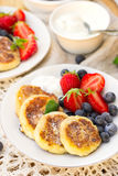 Cottage cheese quark pancakes syrniki with fresh berries. Cottage cheese quark pancakes syrniki with strawberry and blueberry Royalty Free Stock Image