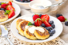 Cottage cheese quark pancakes syrniki with fresh berries. Cottage cheese quark pancakes syrniki with strawberry and blueberry Royalty Free Stock Photos