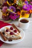 Cottage cheese quiche on flower background. Delicious cottage cheese quiche on plate Stock Photos