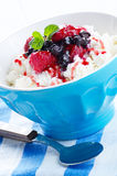 Cottage cheese with raspberries and blueberries Stock Photo