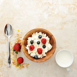 Cottage cheese with raspberries and blueberries in a wooden bowl Stock Photography