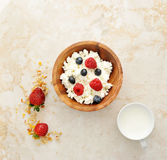 Cottage cheese with raspberries and blueberries in a wooden bowl Royalty Free Stock Images