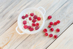 Cottage cheese and raspberries. In a bowl Stock Photos