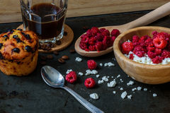 Cottage cheese with raspberries, coffee and blueberry muffin for breakfast Royalty Free Stock Image