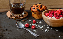 Cottage cheese with raspberries, coffee in a cup and blueberry muffin Stock Photos