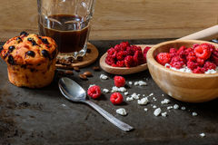Cottage cheese with raspberries, coffee in a cup and muffin for breakfast Royalty Free Stock Photos