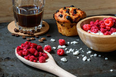 Cottage cheese with raspberries, coffee and muffin for breakfast. Cottage cheese with raspberries, coffee in a cup and blueberry muffin for breakfast with Stock Photography