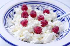 Cottage cheese with raspberry Royalty Free Stock Images