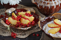 Cottage cheese, red currant and fresh peaches Royalty Free Stock Photo