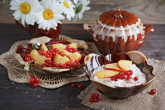 Cottage cheese, red currant and fresh peaches Stock Photo