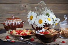 Cottage cheese, red currant and fresh peaches Stock Photography