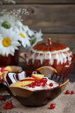 Cottage cheese, red currant and fresh peaches Royalty Free Stock Image