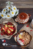 Cottage cheese, red currant and fresh peaches Stock Image