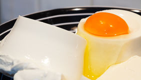 Cottage cheese-ricotta and egg. Royalty Free Stock Photo