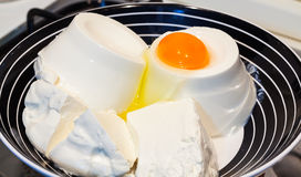 Cottage cheese-ricotta and egg. Stock Photos