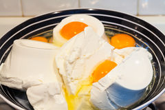 Cottage cheese-ricotta and eggs. Royalty Free Stock Photo